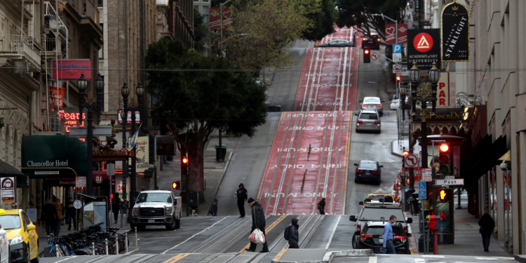 SAN FRANCISCO, CALIFORNIA  - MARCH 16: Few pedestrians walk along Powell Street during commute hours on March 16, 2020 in San Francisco, California. Public areas around the country are mostly empty as people around the country are staying away from from large gatherings in an attempt to slow the spread of COVID-19. (Photo by Justin Sullivan/Getty Images)